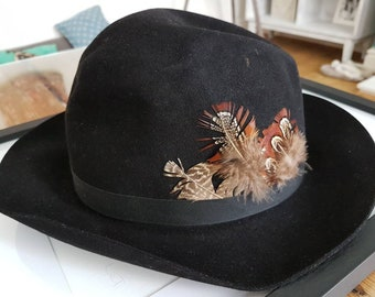 Christys of London black trilby fedora hat with feathers and black ribbon trim, size 6 3/4, 1970s vintage