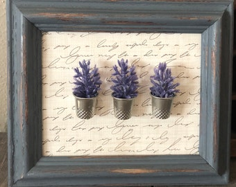 purple flowers in thimbles