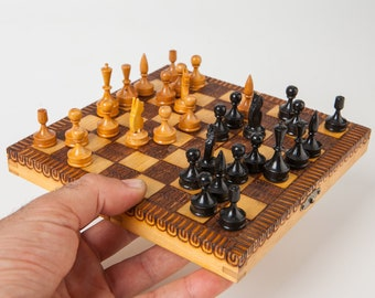 Vintage wooden miniature chess set from the 70's, old portable mini chess