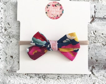 Multi colored floral hand tied bow