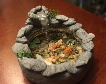 Miniature koi pond in a bottle cap!