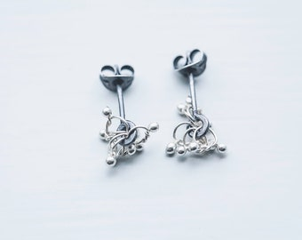 small fine silver studs oxidised recycled sterling silver love knots