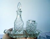 Crystal set for cooking tough dishes with seasonings, with bottles of vinegar, mustard and a suitable tray.