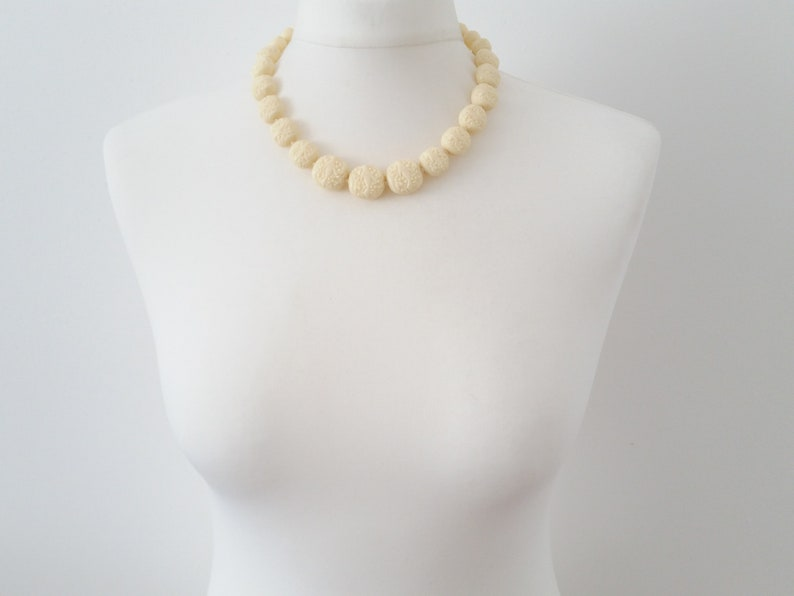 Faux ivory celluloid necklace unusual carved style moulded early plastic graduated bead necklace