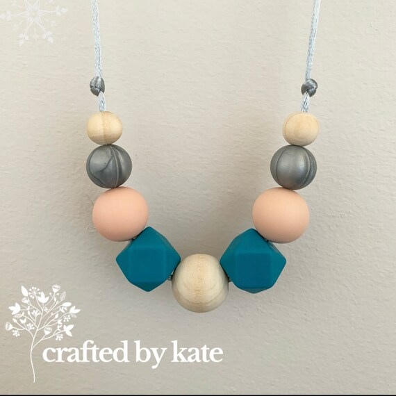 Blue with a hint of peach silicone bead necklace