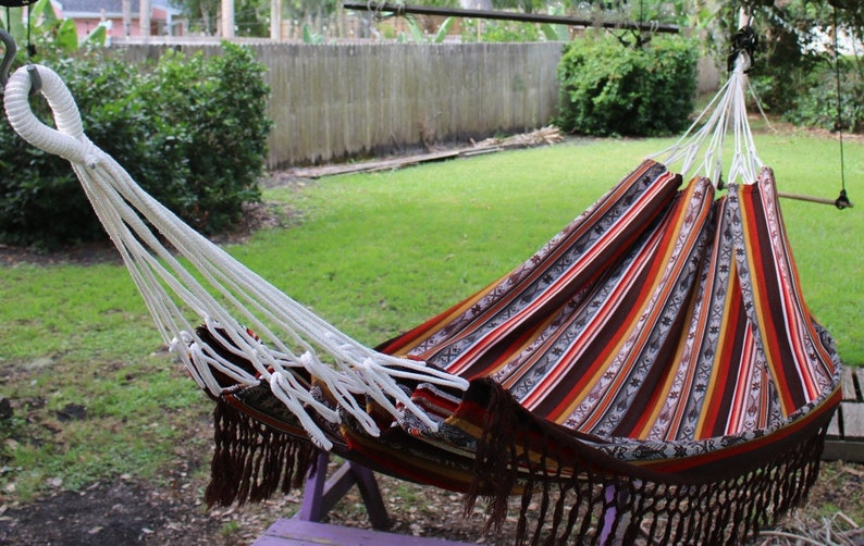 Hammocks are one of the most relaxing things you can have in your yard. Here are 10 inviting backyard ideas for all types of gatherings.