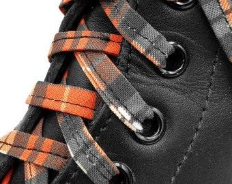 Lacets carreauté orange et noir en tissus, faits au Québec. Embouts plastifiés. Dr Martens, Converse, punk, carreaux tartan