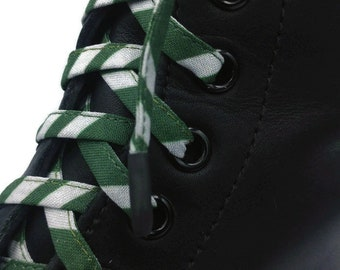 Super Laces Sorcerer's School, home of the snake in fabrics, handmade in Quebec. Dr Martens plastic tips, Slytherin serpent