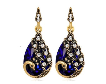 Earrings Peacock 003 Gold optics with blue and white crystals Phoenix Ohringen Earrings