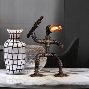 Creative Metal Craft Table Light LamppoDesign Sports Robot Desk Lamp Retro Home Decoration Lighting Gift for Man