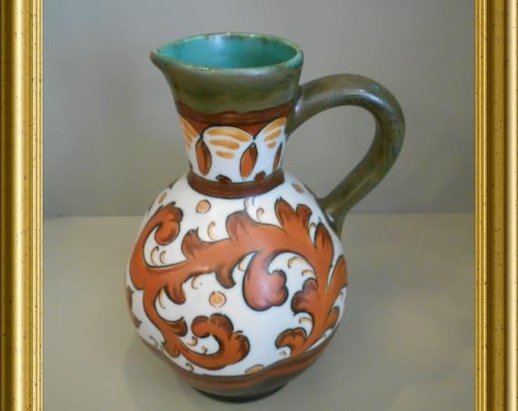 Beautiful handpainted art pottery jug : PZH Gouda, decor Sary