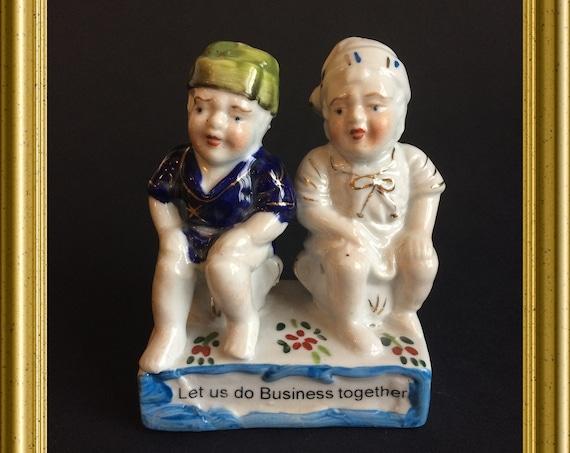 Funny antique porcelain figurine : Let us do business together
