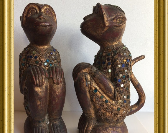 Two vintage wood carved monkeys, decorated with pieces of glass