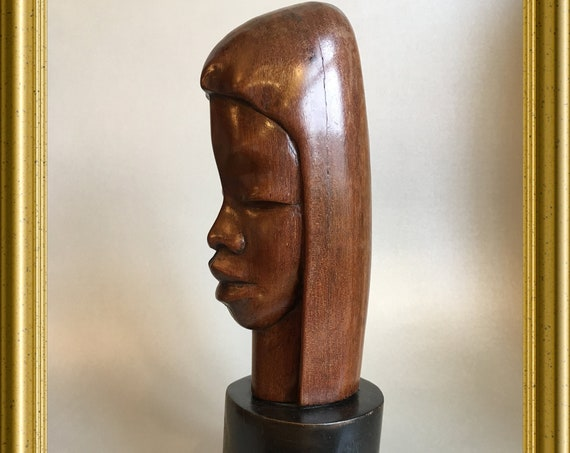 Vintage woodcarving: wooden bust, head