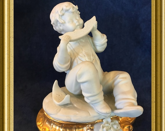 Edoardo Tasca Capodimonte porcelain figurine: boy with melon