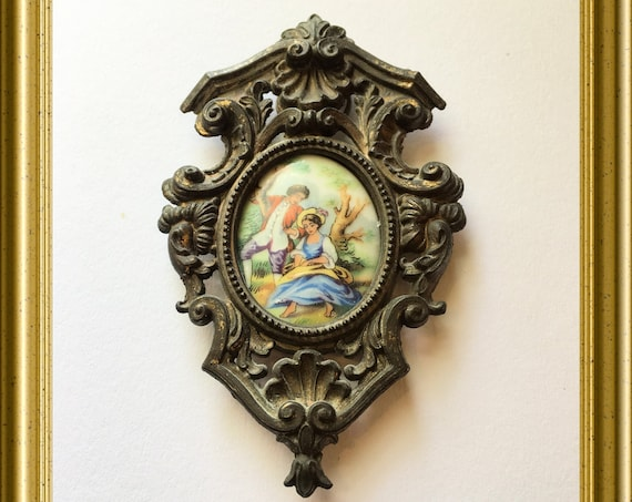 Vintage frame: brass with porcelain