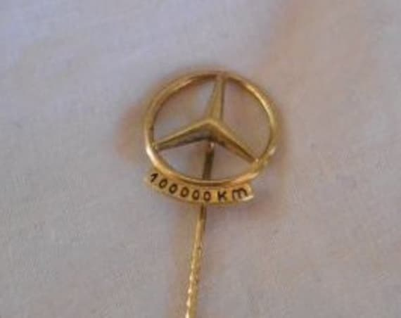 Vintage gold plated silver Mercedes pin: 100000 km