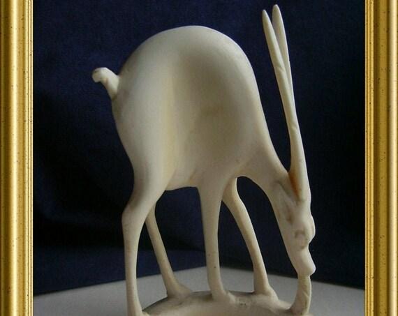 Vintage carved bone figurine: antelope