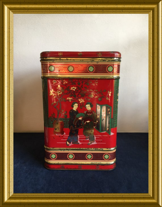 Vintage red tin box with Chinese scenes, geisha