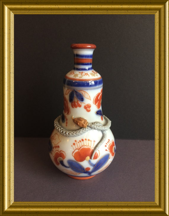Vintage small porcelain Imari vase with snake