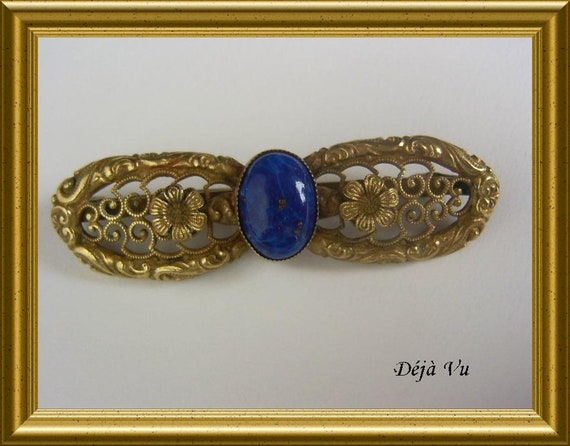 Vintage brooch with blue stone