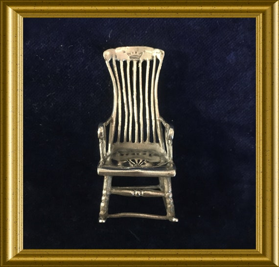 Miniature silver rocking chair