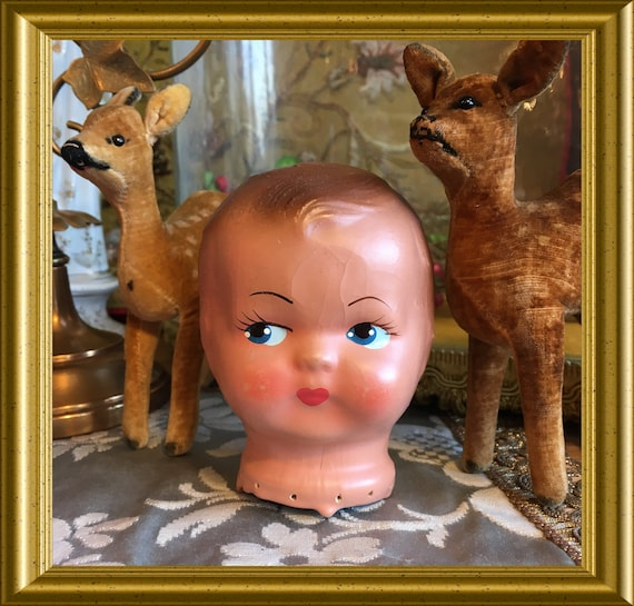 Antique papier mache doll's head