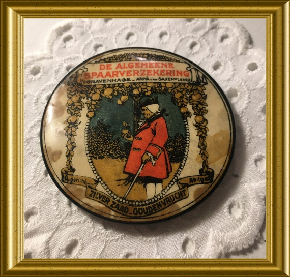 Antique advertisement pocket mirror