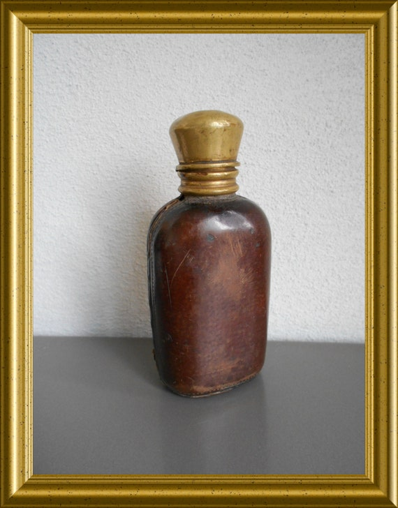 Antique leather cased travel perfume bottle