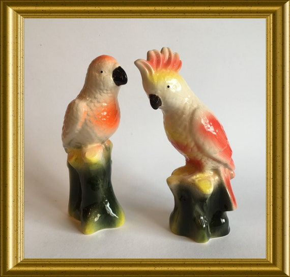 Two vintage bird figurines: parrot