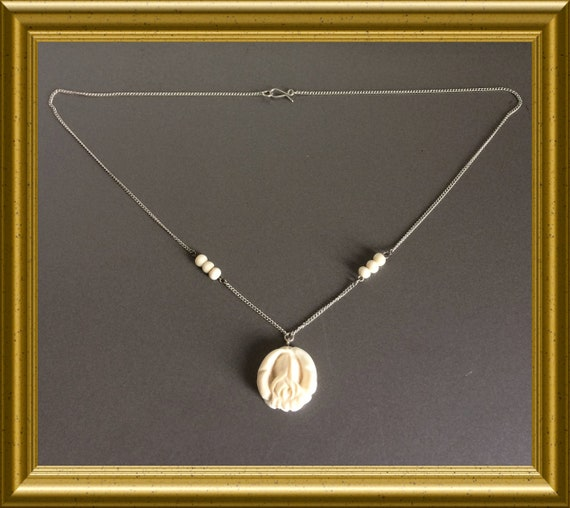 Silver necklace with hand carved rose