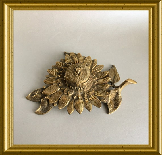 Vintage brass inkwell with glass ink reservoir: sunflower with beetle