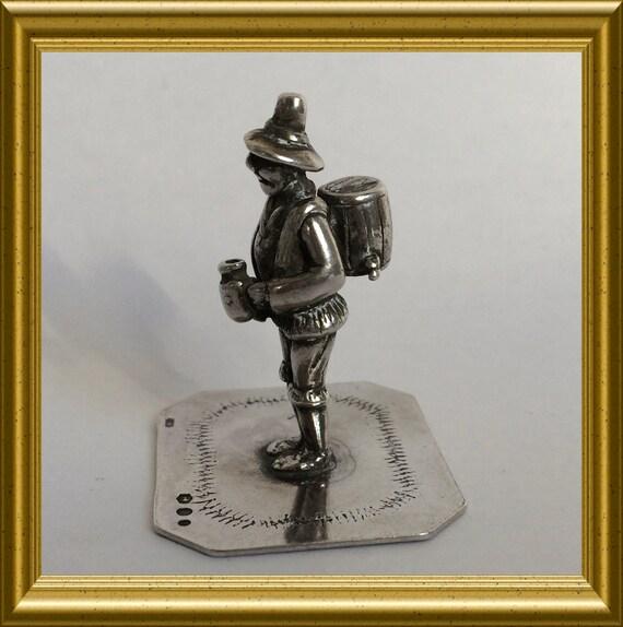 Vintage silver miniature beer salesman