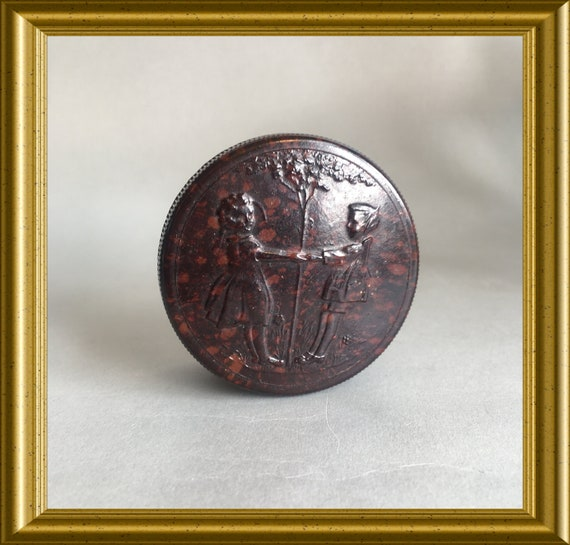 Small round bakelite box with dancing children around a tree decor
