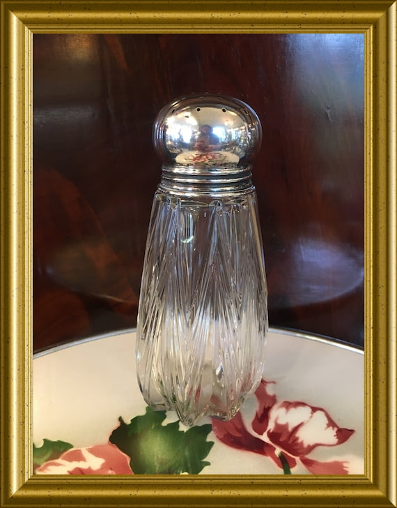 Vintage glass sugar shaker with silver lid