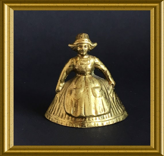 Vintage small brass table bell : Dutch girl, national costume