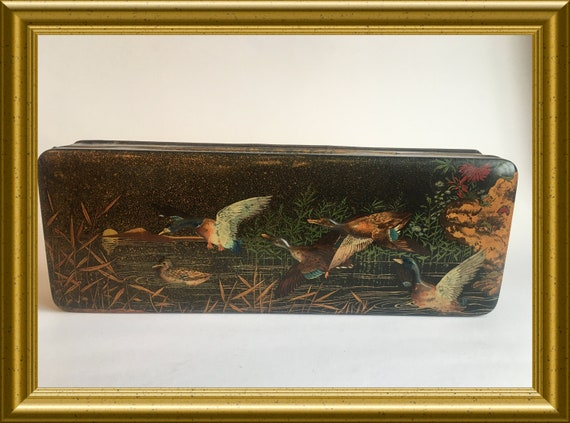 Vintage tin box with decoration of flying ducks in relief