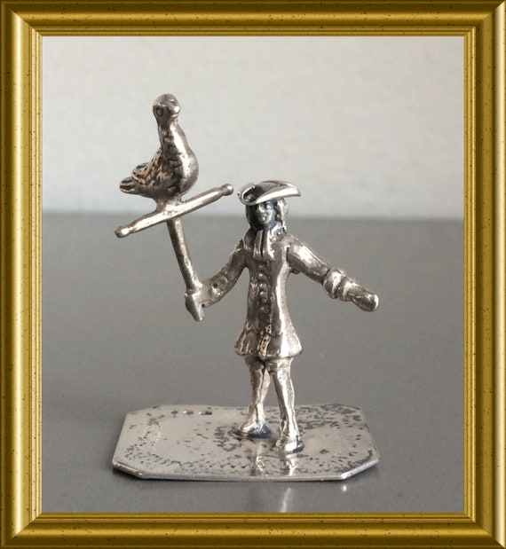 Vintage silver miniature falconer, man with bird