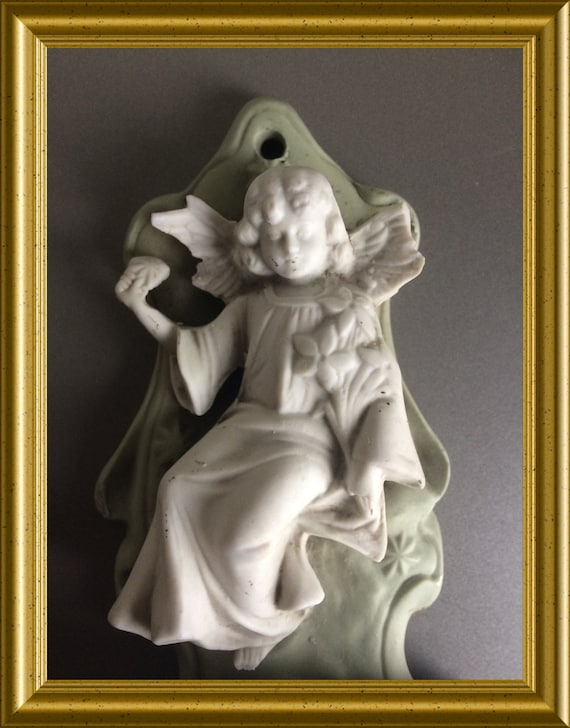 Antique green bisque porcelain holy water font: angel