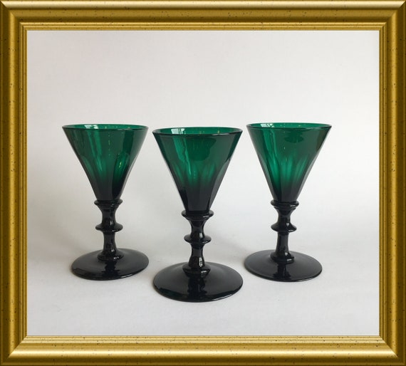 Three antique facet cut emerald green drinking glasses, umbrella glass