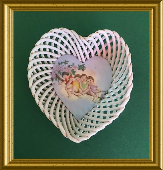 Antique heart shape porcelain bowl, children on a branch