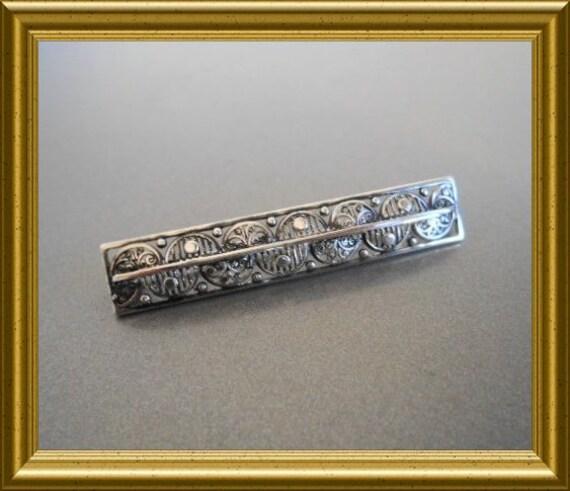 Antique silver (800) brooch