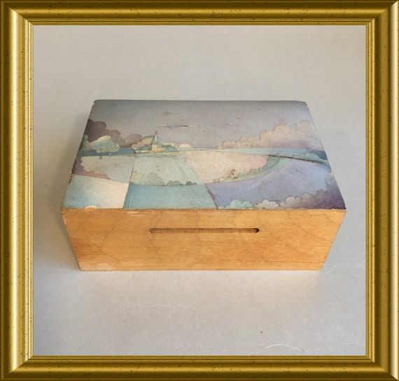 Vintage wooden money bank, money box with secret opening, paper collage