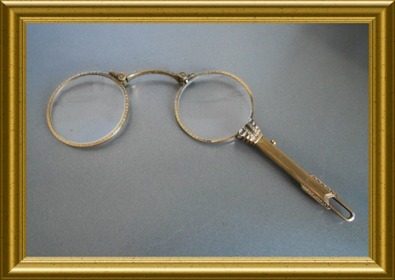 Antique lorgnette, eye glasses, spectacles, folding glasses