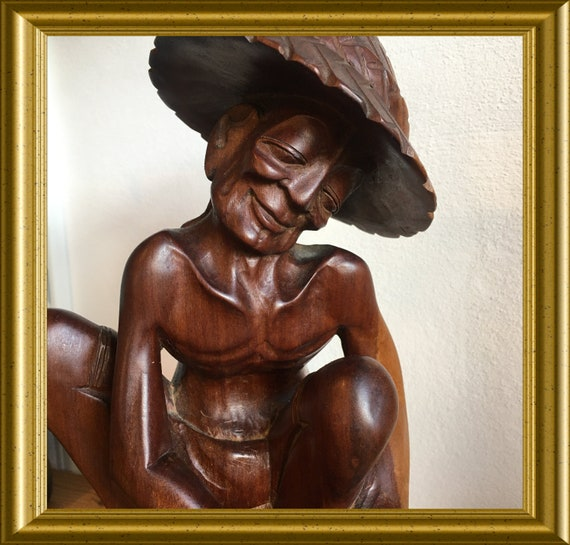 Gorgeous Asian wood carving: wooden figurine of a man
