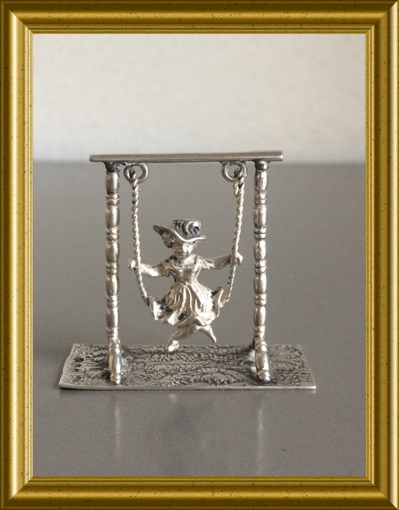 Vintage silver miniature: girl on a swing