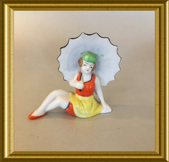 Art deco porcelain figurine: lady with umbrella
