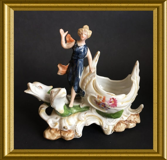 Antique porcelain figurine: lady with sea creatures