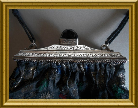 Lovely purse with silver frame
