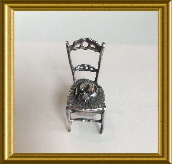 Vintage silver miniature: sleeping cat on chair